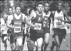 ?? JULIE OLIVER, THE OTTAWA CITIZEN ?? Nepean High School's Ian Donald (1058) was at the front of the pack in the junior boys' 3,000-metre final, but eventually fell back. John Paul Malette (104) of Assumption College in Windsor and Mohamed Ahmed (1637) of St. Catharines Collegiate finished...