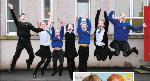 ??  ?? Pupils celebrate, above, as Hannah Burns, 5, Erin McNeil, 5, learn their letters Pictures: Lenny Warren