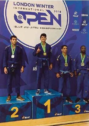 ??  ?? Adam Akasyah (second from left) celebrates on the podium at the London Winter Open Jiu-Jitsu Championship on Saturday.