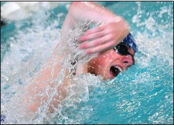 ?? File photo by Ernest A. Brown ?? Tom Brennan and the Cumberland boys swim team finished third at Sunday's Division I meet. Ian Horstkamp-Vinekar claimed two individual events.