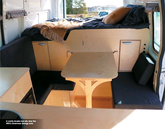 ??  ?? A comfy double bed sits atop the V80's cavernous storage area
