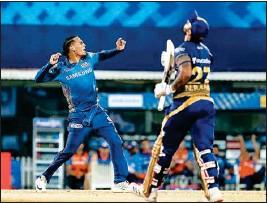 ?? PTI ?? Rahul Chahar of Mumbai Indians celebrates the wicket of Nitesh Rana of Kolkata Knight Riders during Indian Premier League 2021 cricket match between Kolkata Knight Riders and Mumbai Indians at the M. A. Chidambaram Stadium, in Chennai, Tuesday