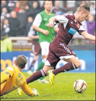 ?? Picture: SNS Group. ?? Billy King skips round Hibs keeper Ben Williams to score Hearts second goal.