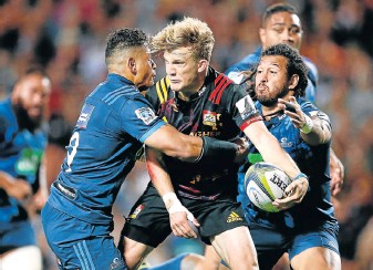 ?? PHOTOGRAPH: GALLO IMAGES ?? NO YOU DON'T: Damian McKenzie of the Chiefs about to pass during the Super Rugby match between the Chiefs and the Blues at Rugby Park Hamilton, New Zealand yesterday