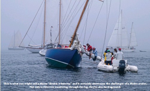 """??  ?? This is what you might call a Maine """"double whammy,"""" and it certainly showcases the challenges of a Maine cruise. Not only is this crew wandering through the fog, they're also hard aground."""