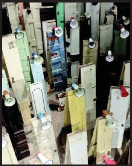 ??  ?? Kader Attia, Asesinos! Asesinos!, 2014, installation: 134 doors and 47 megaphones, variable dimensions.
