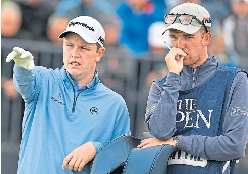 ??  ?? POINTING THE WAY: Scotland's Robert MacIntyre and his caddie during his first Open, which took place at Portrush.