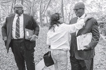 ?? MARY ALTAFFER/AP ?? R. Kelly supporter Carlotte Woods, center, of Kentucky, hugs his attorney Deveraux Cannick, right, as he returns to Brooklyn federal court after a lunch break in the R&B star's trial on Aug. 19, in New York.