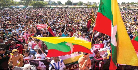 ?? — AFP photo ?? People participate in a rally in support of Suu Kyi at Bago Township.