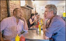 """?? Focus Features / Washington Post News Service ?? Anthony Bourdain, right, with restaurateur David Chang, in """"Roadrunner: A Film About Anthony Bourdain."""""""