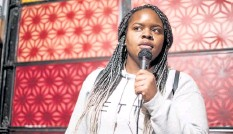 ?? Courtesy photo ?? Comic Shanel Hughes, pictured performing at the Denver Comedy Lounge, will perform in Boulder for the festival.
