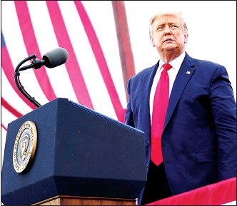 ??  ?? In this Sept 10 file photo President Donald Trump arrives for a campaign rally at MBS International Airport in Freeland, Mich. Pushing for new roads to reelection,Trump will go on offense this weekend in Nevada, a state that hasn't supported a Republican presidential candidate since 2004. (AP)