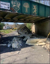 ?? RICHARD ILGENFRITZ - MEDIANEWS GROUP ?? The rear portion of a box truck was completely smashed after hitting the bridge on the Radnor Trail over South Devon Road in Radnor late Monday morning.