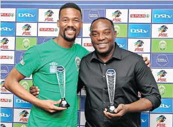 ?? | GERHARD DURAAN BackpagePix ?? VELI MOTHWA and Benni McCarthy with their Premiership Player and Coach of the Month awards at Kings Park yesterday.