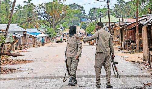 ?? | EPA-EFE ?? SOLDIERS patrol the streets of Palma, Cabo Delgado, Mozambique, after armed groups attacked the town in April.
