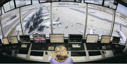 ?? THOMAS LOHNES/GETTY IMAGES/FILES ?? A control tower operator supervises planes taking off and landing from a control tower at Frankfurt international airport in Germany. A shortage of air traffic controllers could hurt the aviation industry's expansion plans over the next two decades.