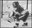 ?? colleen De Neve, calgary Herald ?? Jarome Iginla notches his hattrick past Oilers goalie Nikolai Khabibulin at the Saddledome.