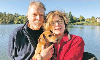 """?? VIA SKIP DEAN ?? Retired couple Skip Dean, left, and Denbigh Atack Dean, with mini dachshund Coco, moved here from Toronto and have discovered it's a """"tough go"""" to find a house to rent in their price range."""