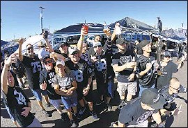 """?? David Becker Associated Press ?? RAIDERS FANS congregate before """"Monday Night Football"""" for the first regular-season game at Allegiant Stadium in Las Vegas in front of a live audience."""