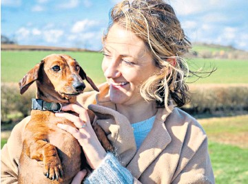 ??  ?? g Woman's best friend: Kate MacDougall knows how to keep those pooches happy