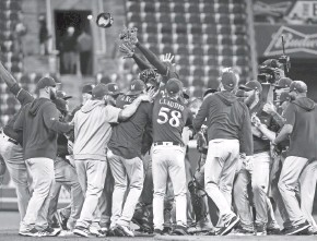 ?? ASSOCIATED PRESS ?? The Milwaukee Brewers celebrate clinching a playoff spot with a victory over the Cincinnati Reds on Sept. 25.