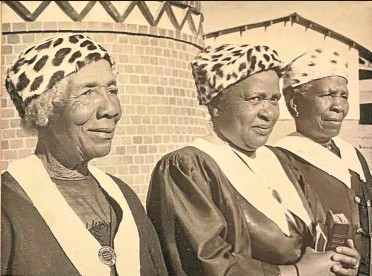 """??  ?? Three AME Manyano women. The author writes: 'Though Maxeke only became president of the South African AME's Women's Missionary Society in 1920, at least two decades into its existence, most AME women will tell you that Maxeke is the """"mother"""" of their organisation. Likewise, most AME women name Maxeke as the designer of their distinctive """"missionary uniform"""" — their leopard-skin hat, black gown, white sash and AME badge. Victoria Gabeshane was in fact the designer — but such is the power of Maxeke's myth and legend within the Southern African AME church.'"""
