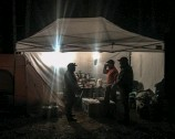 ??  ?? On the last night of camp in 2018, Anthony, Greg, and Nate trade stories of that day's hunts inside the kitchen tent.