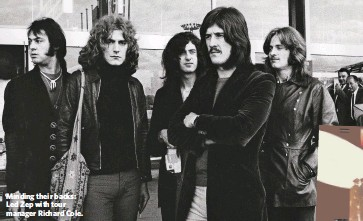??  ?? Minding their backs: Led Zep with tour manager Richard Cole.