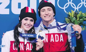 ?? NATHAN DENETTE/THE CANADIAN PRESS ?? After being silver medallists at the 2014 Sochi Olympics, Canadian ice dancers Tessa Virtue and Scott Moir are back for another go-round, eager to take on the world's best teams.
