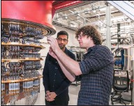 """?? GOOGLE VIA THE NEW YORK TIMES ?? Google CEO Sundar Pichai, left, and a researcher view Google's quantum computer. Google said it had achieved """"quantum supremacy,"""" which could allow computer calculations at speeds inconceivable today."""