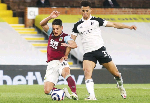 ?? Reuters ?? ↑ Burnley's Ashley Westwood (left) scores a goal against Fullham during their Premier League match on Monday.