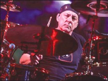 ?? Canadian Press photo ?? Neil Peart of Rush performs during the final show of the R40 Tour at The Forum on Saturday, Aug. 1, 2015, in Los Angeles. Peart, drummer of Canadian rock band Rush, has died at 67, according to a representative for Geddy Lee.