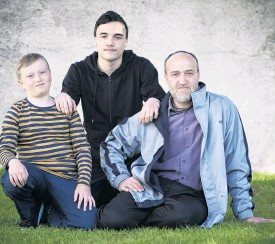 ?? PHOTO: GERARD O'BRIEN ?? Moving forward . . . Fashwel family members (from left) Anas (10), Abdel Karim (16) and their father Walid are putting on brave faces and getting on with rebuilding their lives, after their family home burnt down in Mosgiel earlier this week.