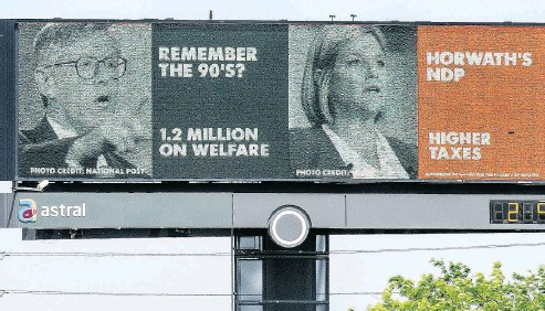 """?? PETER J THOMPSON / NATIONAL POST ?? An election billboard compares former Ontario premier Bob Rae and Ontario NDP Leader Andrea Horwath. Does Ontario politics have to be a contest of ideas in which """"half-baked"""" is the best we can hope for? Chris Selley asks."""