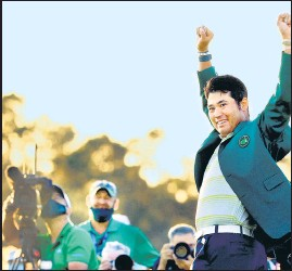 ?? GETTY IMAGES VIA AFP ?? Hideki Matsuyama celebrates after becoming the first golfer from Japan to win a major and the first Asian to win the Masters, at the Augusta Nationals in Georgia on Sunday.