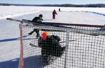 ??  ?? Children and friends of Canadianhockeymoms.ca blogger Theresa Dostaler enjoy skating on Moira Lake. Shown in the photo are Theresa's sons Kobe, in goal, and Kellen, taking the shot, and daughter Shea, who is looking on. In the background is family...