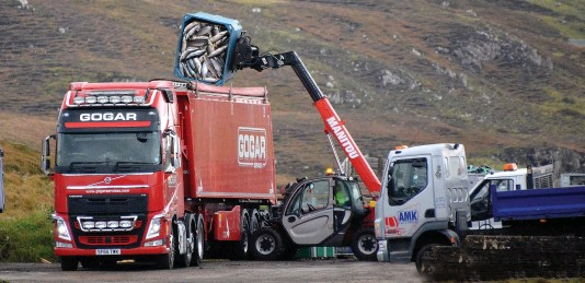 ??  ?? Waste: Tons of salmon are dumped into a lorry at Loch Erisort on Lewis to be transported hundred of miles for incineration