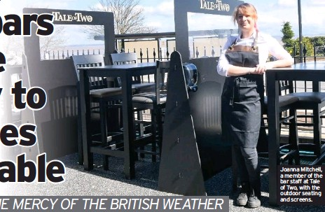 ??  ?? Joanna Mitchell, a member of the bar staff at Tale of Two, with the outdoor seating and screens.