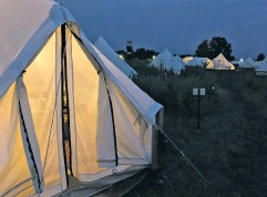 ?? PHOTO BY LAURA MARTIN ?? Canvas tents with electricity, comfortable beds and even a safe for valuables seem inviting in a rainstorm.
