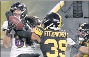 ?? THE ASSOCIATED PRESS ?? Pittsburgh free safety Minkah Fitzpatrick breaks up a pass in the end zone to Baltimore tight end Luke Willson as time runs out in first half of the Steelers' home win Wednesday.
