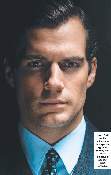 ?? The Man From U.N.C.L.E. ?? Henry Cavill avoids imitation as he steps into big shoes; (above) with Armie Hammer in