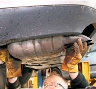 ??  ?? Once freed, manipulate the old exhaust section out from beneath the car, taking care not to damage any adjacent parts and paintwork. Old exhausts can be disposed of as scrap metal at your local household recycling centre.