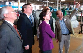 ?? Photo by Russ Olivo ?? Brickle Group President Max Brickle leads Gov. Gina Raimondo and Mayor Lisa Baldelli-Hunt on a tour of the third-generation family textile manufacturing company on Singleton Street Thursday.