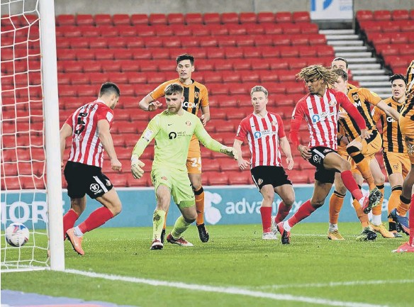 ??  ?? Reece Burke scores for Hull. Pictures by Frank Reid.