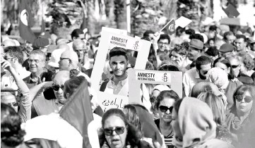 ??  ?? Protesters shout slogans during a march, demanding equal inheritance rights for women, in Tunis. — Reuters photo