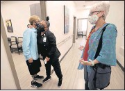 ?? ALEXA WELCH EDLUND/TIMES-DISPATCH ?? Hanger Clinic office administrator LaQuinta Jones hugged Saule Sadykova after she and Victoria Charbonneau (right) arrived Wednesday. Charbonneau brought Saule to Virginia from Kazakhstan to be fitted for a new prosthesis.