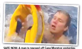 ??  ?? SAFE NOW: A man is rescued off Cape Moreton yesterday.