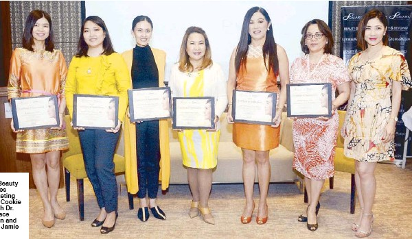 ??  ?? (From left) Makati Med­i­cal Cen­ter's Dr. Trixie Carpo, Asian Hos­pi­tal and Med­i­cal Cen­ter's Dr. Bev­erly Amoranto, St. Luke's Med­i­cal Cen­ter Boni­fa­cio Global City's Dr. Irene Gaile Ro­bredo Vitas, Philip­pine Der­ma­to­log­i­cal So­ci­ety pres­i­dent Dr. Peachy Paz-Lao, Re­search In­sti­tute for Tropical Medicine's Dr. Tere­sita Gabriel, Asian Hos­pi­tal and Med­i­cal Cen­ter's Dr. Loverna Su­ratos and DMARK Beauty Cor­po­ra­tion CEO Nikki Tang