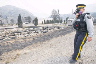 ?? CP PHOTO ?? The area of Boston Flats, B.C. is pictured July 11 after a wildfire ripped through the area earlier in the week. The new British Columbia government is extending the state of emergency for another two weeks as wildfires continue to sweep across the...