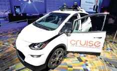 ?? Daniel Mears / The Detroit News ?? Cruise has raised more than $8 billion and ultimately wants to offer fully autonomous vehicles in most environments.